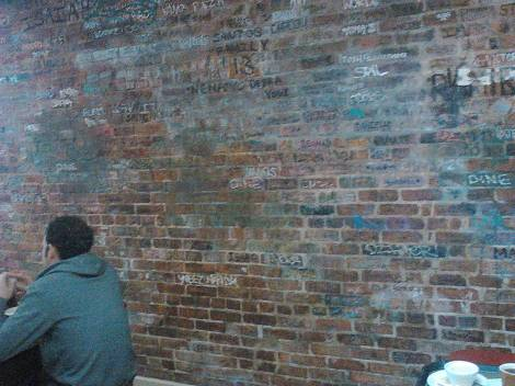 Every bare brick wall upstairs has a customer's signature...